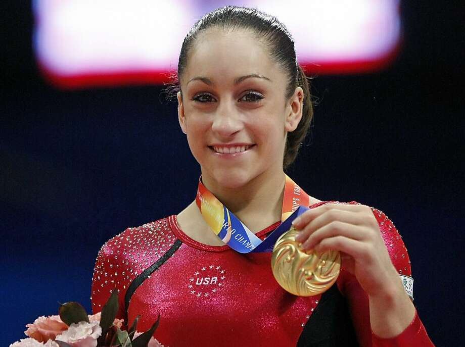 USA's Jordyn Wieber smiles with the gold medal on the podium after winning the women's individual all-round final at  the Artistic Gymnastics World Championships in Tokyo, Japan, Thursday, Oct. 13, 2011. (AP Photo/Bullit Marquez) Photo: Bullit Marquez, AP