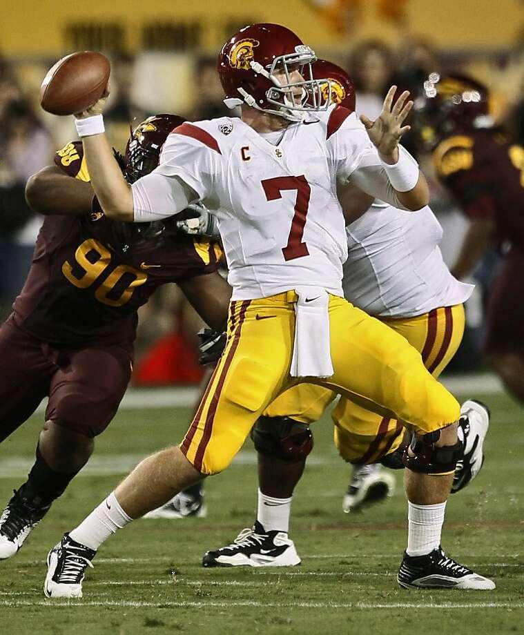 Southern California quarterback Matt Barkley (7) throws against Arizona State during the first half of an NCAA college football game, Saturday, Sept. 24, 2011, in Tempe, Ariz. (AP Photo/Matt York) Photo: Matt York, AP