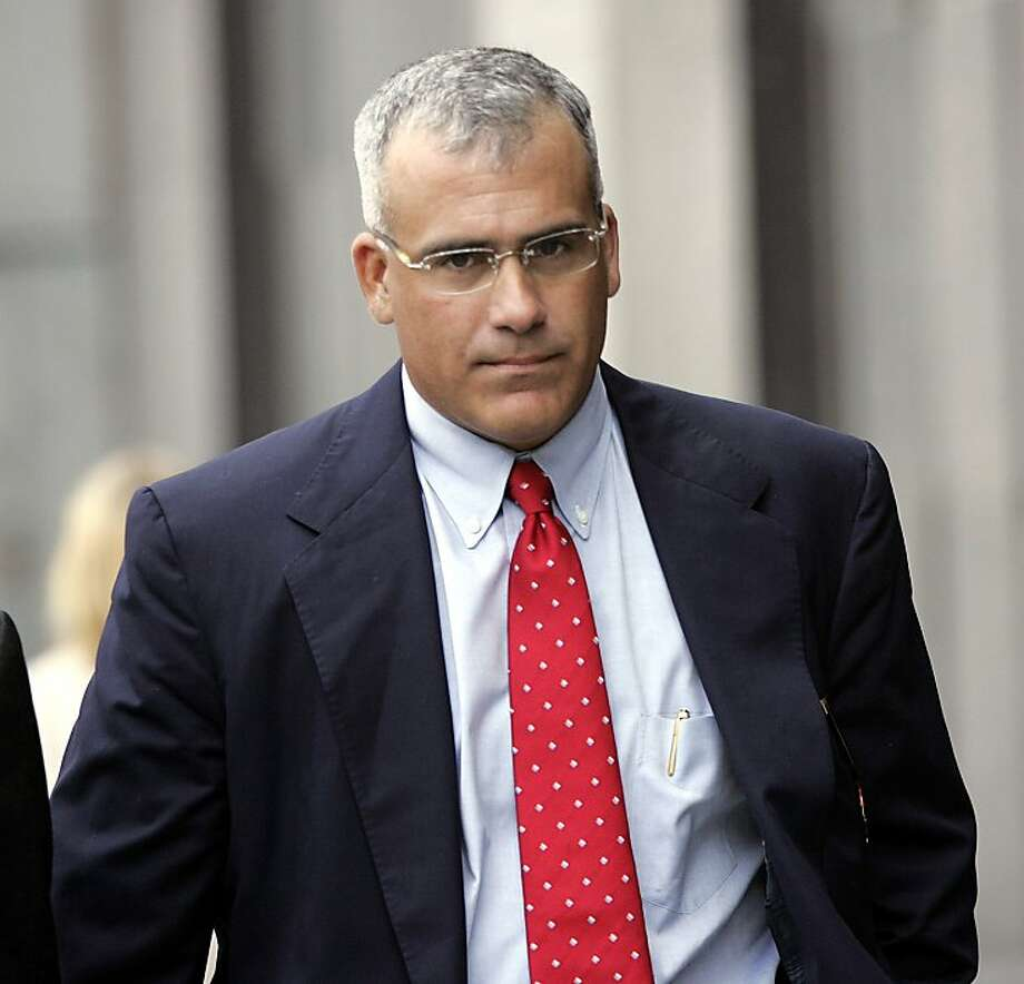 **FILE**Brocade's former CEO Gregory Reyes, walks into a federal courthouse in San Francisco, in this Wednesday, Aug. 2, 2006 file photo. Reyes either masterminded a stock options backdating scheme designed to defraud investors, or fell victim to murky accounting laws and heightened public scrutiny to corporate accounting errors, lawyers said Monday, June 18, 2007. The criminal trial against Reyes, charged with 10 felony counts of securities fraud and other offenses, began Monday in a federal courtroom. Reyes' case is the first to go to trial alleging criminal offenses connected to suspect timing of stock option awards.  (AP Photo/Paul Sakuma, file) Ran on: 06-21-2007 Former Brocade CEO Greg Reyes, shown in a 2006 photo, got hit by an ex-employee's testimony in court Wednesday. Ran on: 07-27-2007 Former Brocade CEO Gregory Reyes, shown walking into court in 2006, should not be considered guilty simply because his company violated accounting rules, his attorney said Thursday. But prosecutors argued that he oversaw a &quo;knowing and intentional scheme.&quo; ALSO Ran on: 08-08-2007 Gregory Reyes Ran on: 08-08-2007 Gregory Reyes Ran on: 08-08-2007  Ran on: 08-08-2007  Ran on: 08-08-2007  Ran on: 08-08-2007  Ran on: 08-08-2007  Ran on: 08-08-2007  Ran on: 08-08-2007    Ran on: 03-27-2010 Gregory Reyes Photo: Paul Sakuma, AP