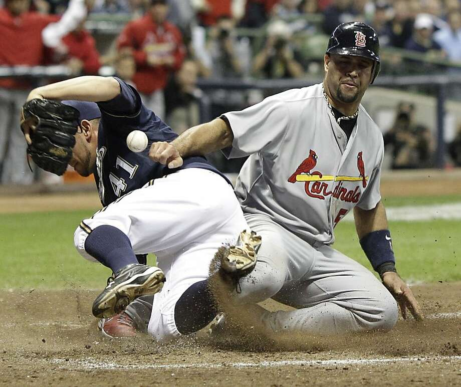 St. Louis Cardinals' Albert Pujols (5) slides safely past Milwaukee Brewers' Marco Estrada (41) to score during the fifth inning of Game 2 of baseball's National League championship series Monday, Oct. 10, 2011, in Milwaukee. (AP Photo/David J. Phillip) Photo: David J. Phillip, AP
