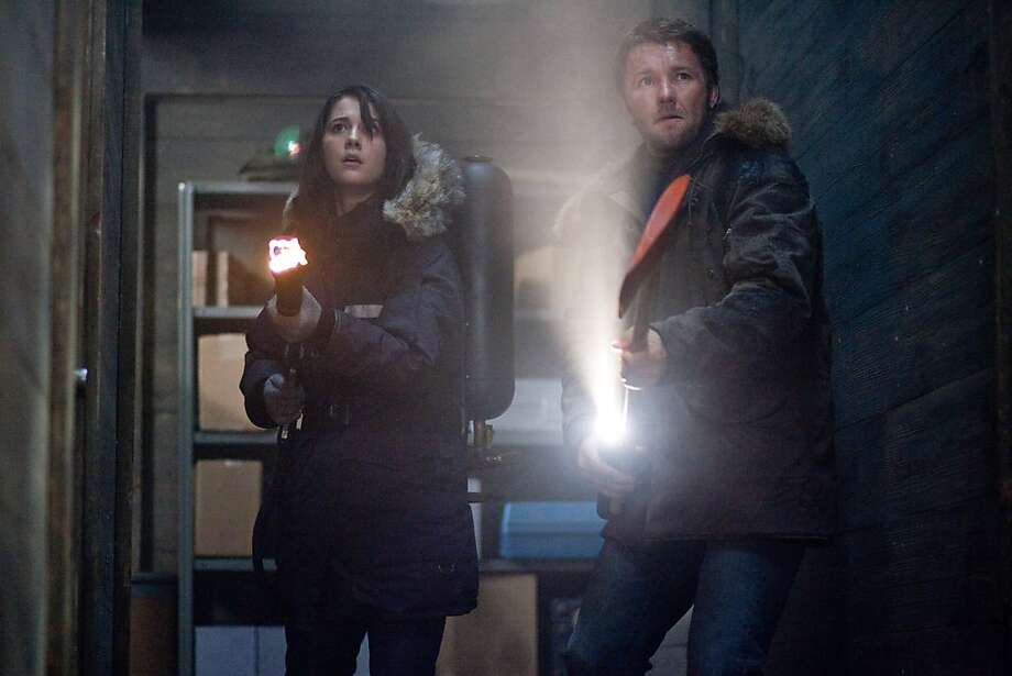 "Kate (MARY ELIZABETH WINSTEAD) and Carter (JOEL EDGERTON) ready for battle in ""The Thing"". In the thriller, paranoia spreads among a group of researchers as they encounter something inhuman that has the ability to turn itself into an exact replica of any living being. Photo: Kerry Hayes, Universal Pictures"