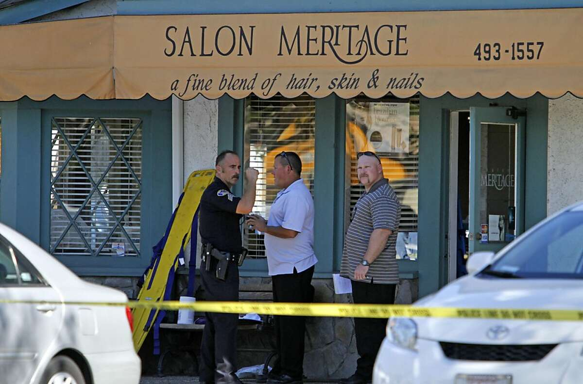 Investigators stand near the site where six people were killed and three were wounded in a shooting at a hair salon in Seal Beach, Calif., Wednesday, Oct. 12, 2011. Police Sgt. Steve Bowles says a man was taken into custody near the scene and investigators are trying to determine if he has a relationship to the salon or anyone there. (AP Photo/Los Angeles Times, Robert Lachman) NO FORNS; NO SALES; MAGS OUT; ORANGE COUNTY REGISTER OUT; LOS ANGELES DAILY NEWS OUT; VENTURA COUNTY STAR OUT; INLAND VALLEY DAILY BULLETIN OUT; SAN BERNARDINO SUN OUT; MANDATORY CREDIT, TV OUT