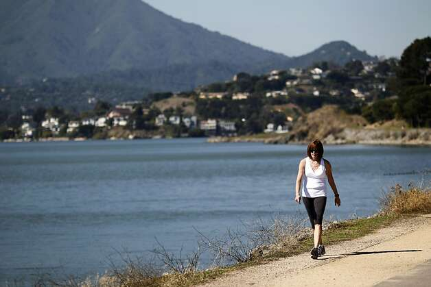 "Alane Cornelius, of Minneapolis, walks along Tiburon Linear Park on Thursday, October 13, 2011 in Tiburon, Calif. ""I try to walk 4 to 6 miles, 3 to 4 times a week,"" Cornelius said. Photo: Beck Diefenbach, Special To The Chronicle"