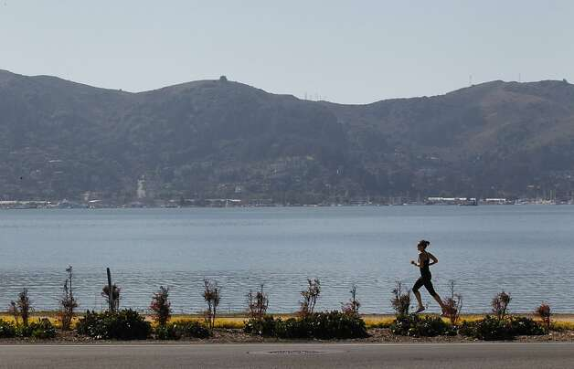 A runner makes her way along Tiburon Linear Park on Thursday, October 13, 2011 in Tiburon, Calif. Photo: Beck Diefenbach, Special To The Chronicle