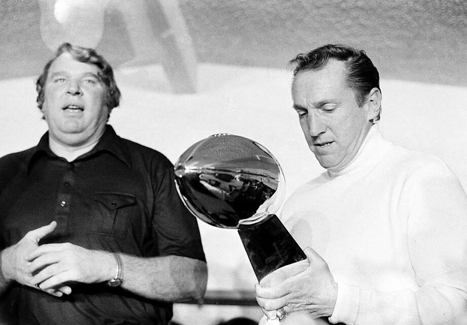 FILE - In this Jan. 9, 1977, file photo, Oakland Raiders coach John Madden, left, talks as team owner Al Davis holds the Vince Lombardi Trophy after the Raiders' 32-14 victory over the Minnesota Vikings in Super Bowl XI  in Pasadena, Calif.  Davis, the Hall of Fame owner of the Raiders known for his rebellious spirit, has died, the team announced on Saturday, Oct. 8, 2011. (AP Photo/File)  Ran on: 10-09-2011 Coach John Madden (left) with Mr. Davis after the Raiders won Super Bowl XI. Ran on: 10-09-2011 Coach John Madden (left) with Mr. Davis after the Raiders won Super Bowl XI. Photo: AP