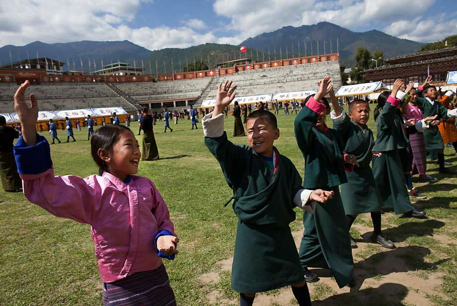 THIMPHU, BHUTAN - OCT 12 :  Bhutanese students practices a dance for the upcoming Royal wedding celebrations at a stadium October 12, 2011, in Thimphu, Bhutan.  His majesty King Jigme Khesar Namgyel Wangchuck, 31, will wed Jetsun Pema, 21, on October 13 in the historical Punakha Dzong, the same venue that hosted the King's historical coronation ceremony in 2008. The Oxford-educated king is popular in the country and the ceremony will be followed by celebrations in the capital and nationwide. (Photo by Paula Bronstein /Getty Images) Photo: Paula Bronstein, Getty Images