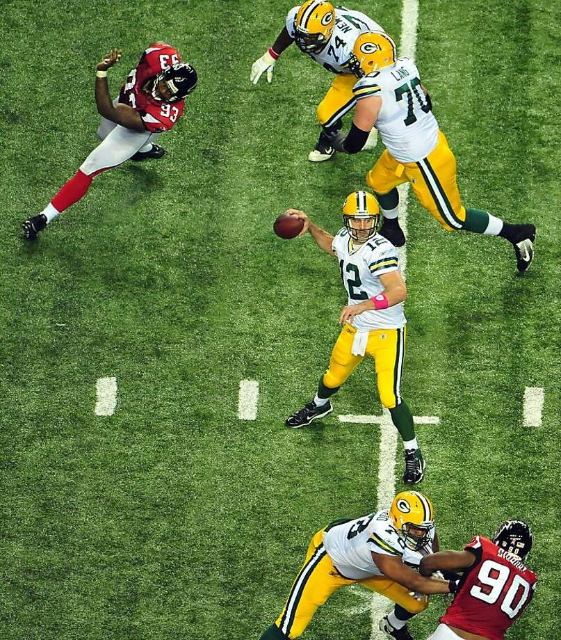 Green Bay Packers quarterback Aaron Rodgers (12) looks to pass against the Atlanta Falcons during the second half of an NFL football game, Sunday, Oct. 9, 2011, in Atlanta. (AP Photo/Pouya Dianat) Photo: Pouya Dianat, AP