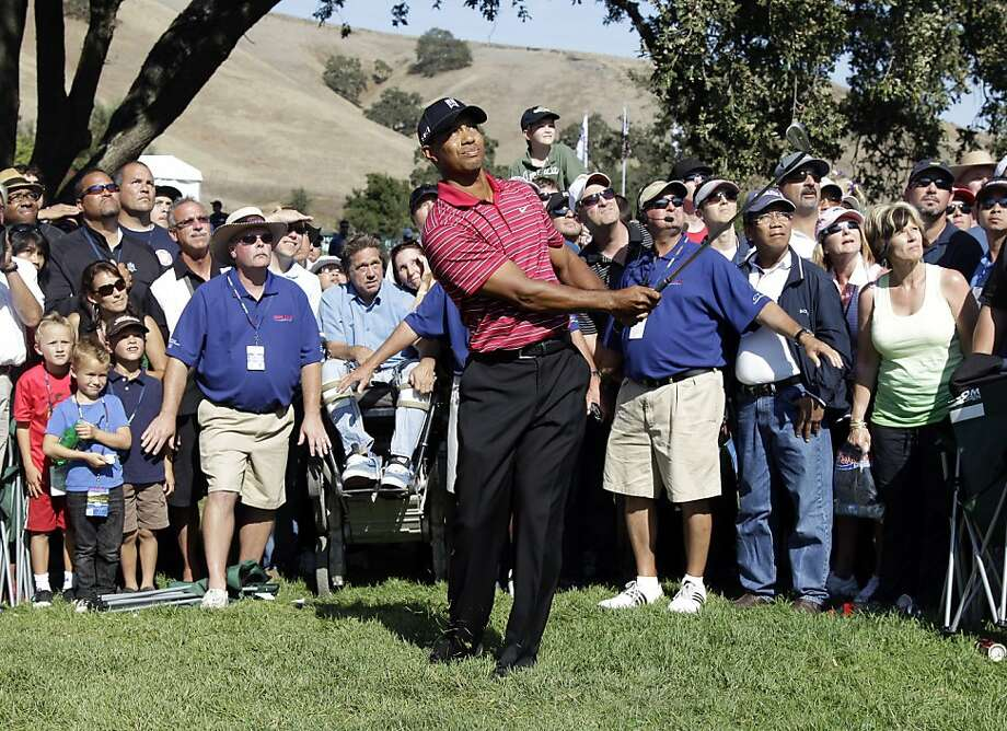 Tiger Woods chips to the green on the ninth hole during the final round of the Frys.com Open golf tournament, Sunday, Oct. 9, 2011, in San Martin, Calif. (AP Photo/Marcio Jose Sanchez)  Ran on: 10-10-2011 Tigers Woods chips to the green on the ninth hole, where he completed his third consecutive 68 at the Frys.com Open. Photo: Marcio Jose Sanchez, AP