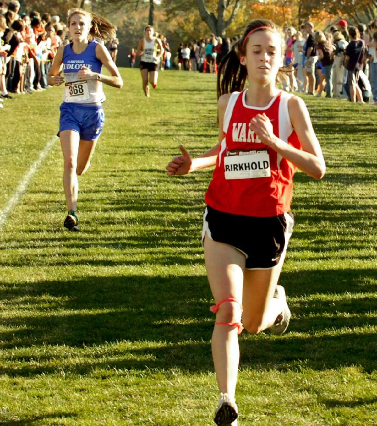 Carly Birkhold, of Warde, fourth in the girls varsity cross country championship race at Waveny Park in New Canaan, on Thursday, Oct.22,2009.