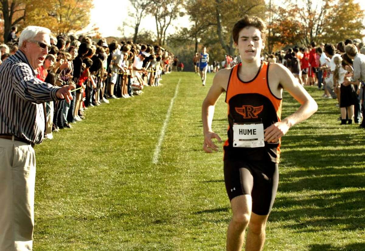 Richie Hume, of Ridgefield, winner of the boys varsity cross country championship race at Waveny Park in New Canaan, on Thursday, Oct.22,2009.
