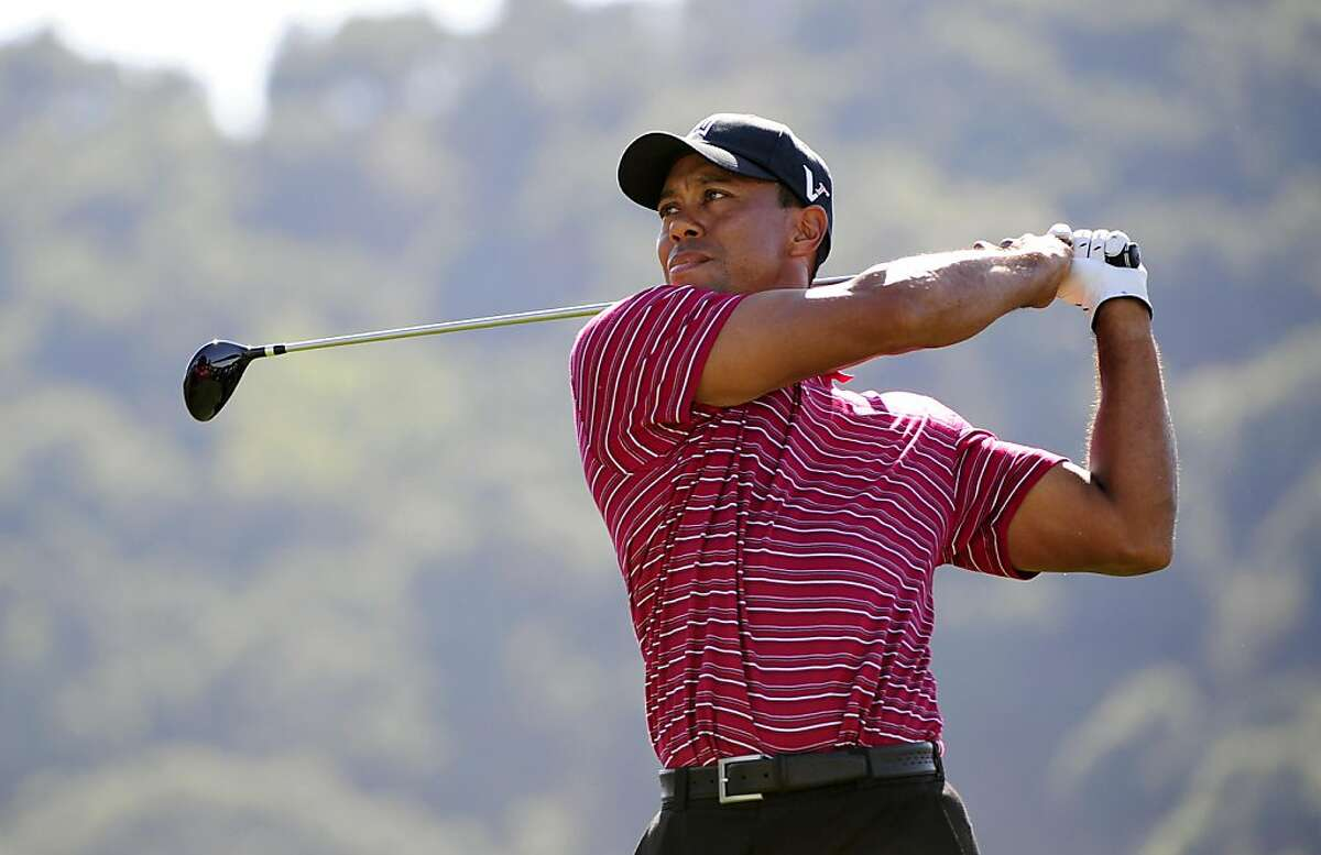 SAN MARTIN, CA - OCTOBER 09: Tiger Woods makes a tee shot on the ninth hole during the final round of the Frys.com Open at the CordeValle Golf Club on October 9, 2011 in San Martin, California. (Photo by Robert Laberge/Getty Images)