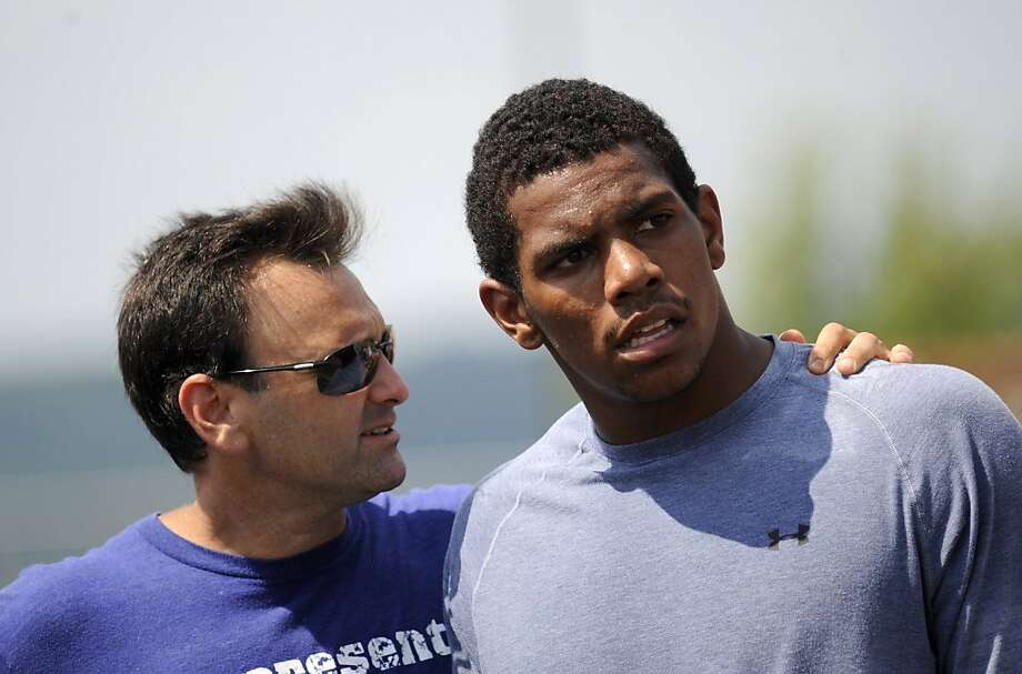 Former Ohio State quarterback Terrelle Pryor, right, and his agent, Drew Rosenhaus, talk as Pryor worked out for NFL football scouts Saturday, Aug. 20, 2011, in Greensburg, Pa. (AP Photo/Post-Gazette, Rebecca Droke) MONESSEN, KITTANNING, CONNELLSVILLE, GREENSBURG, TARENTUM, NORTH HILLS NEWS RECORD, BUTLER OUT  MAGS OUT  NO SALES  Ran on: 08-24-2011 Terrelle Pryor has been close to his agent, Drew Rosenhaus. Will Pryor be an agent of change for the Raiders? Photo: Rebecca Droke, AP