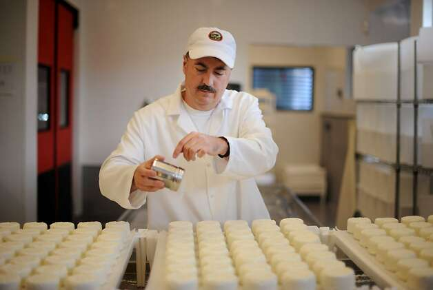 Head cheesemaker Scott Lafranchi salting Foggy Morning; a fresh cowÕs milk cheese at Nicasio Valley Cheese Company in Nicasio, California. After the salting, the cheese is ready to eat in about two days. October 5, 2011 Photo: Erik Castro, Special To The Chronicle