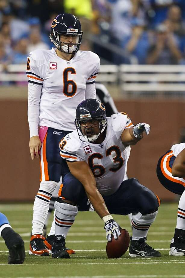 Chicago Bears center Roberto Garza (63) and Chicago Bears quarterback Jay Cutler (6) during an NFL football game against the Detroit Lions in Detroit, Monday, Oct. 10, 2011. (AP Photo/Rick Osentoski) Photo: Rick Osentoski, AP