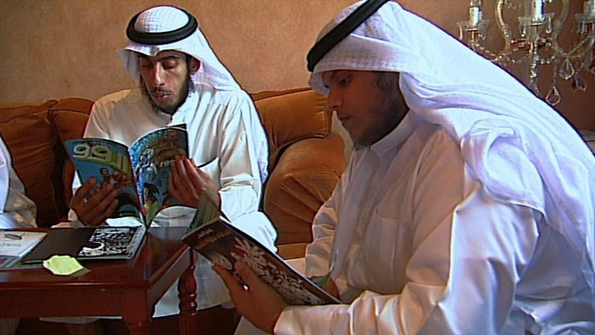 Students at Kuwait University read