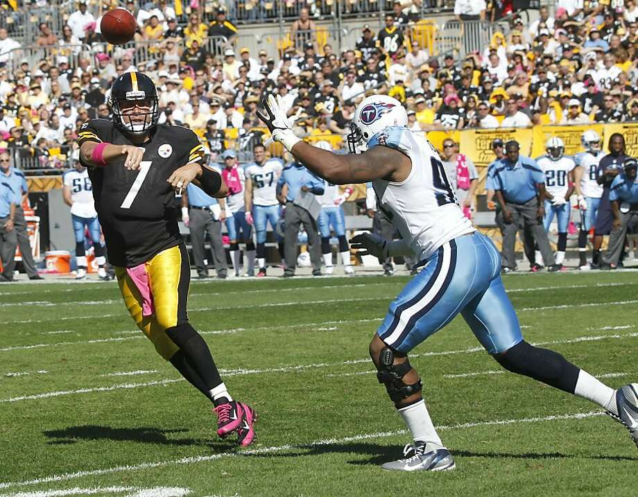 Pittsburgh Steelers quarterback Ben Roethlisberger (7) gets a pass off for a touchdown as Tennessee Titans defensive end Jason Jones (91) pressure in the second quarter of the NFL football game, Sunday, Oct. 9, 2011, in Pittsburgh. (AP Photo/Keith Srakocic) Photo: Keith Srakocic, AP