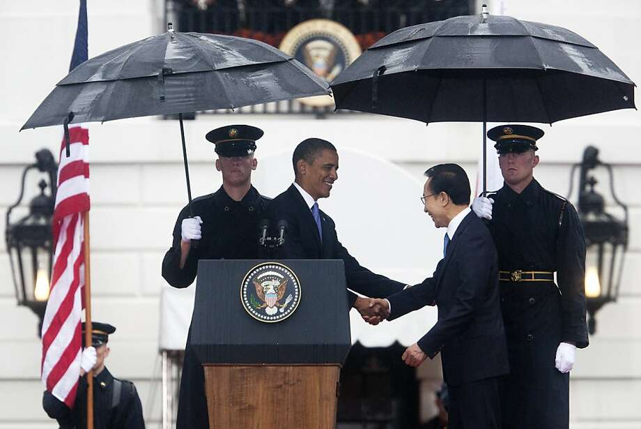 President Barack Obama and South Korean President Lee Myung-bak shake hands during an official arrival ceremony, at the White House in Washington, Oct. 13, 2011 Obama welcomed Lee to the White House on Thursday just hours after Congress passed a trade pact between South Korea and the United States. (Philip Scott Andrews/The New York Times)  Ran on: 10-16-2011 President Obama and South Korean President Lee Myung-bak. Ran on: 10-16-2011 President Obama and South Korean President Lee Myung-bak. Photo: Philip Scott Andrews, The New York Times