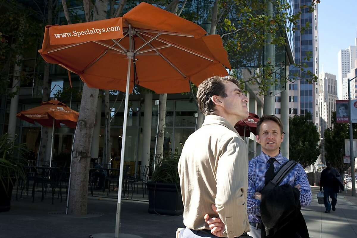 Scott Stollman (center) stands with Eric Eidlin (right) In front of Specialty's CafŽ & Bakery on Friday, October 7, 2011 in San Francisco, Calif. The 2-month-old cafe fills a retail space in the Foundry Square building that had previously been empty for eight years.