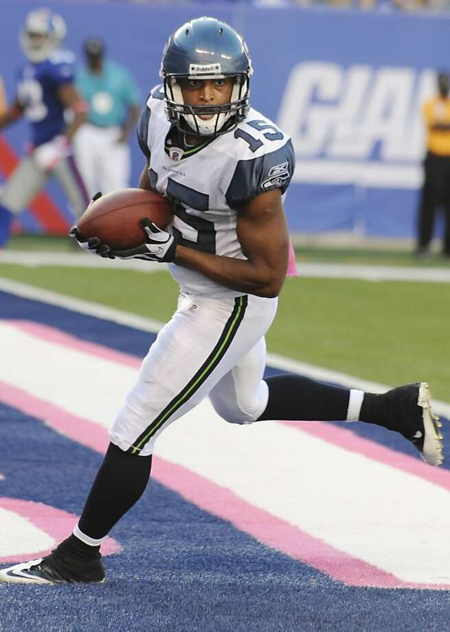 Seattle Seahawks wide receiver Doug Baldwin (15) scores a touchdown during the fourth quarter of an NFL football game against the New York Giants Sunday, Oct. 9, 2011, in East Rutherford, N.J. The Seahawks won the game 36-25. (AP Photo/Bill Kostroun) Photo: Bill Kostroun, AP