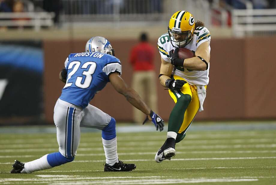Green Bay Packers wide receiver Brett Swain (16) runs the ball at Detroit Lions cornerback Chris Houston (23) in the first half of the NFL football game against the Detroit Lions in Detroit, Sunday , Dec. 12, 2010. Detroit won 7-3. (AP Photo/Rick Osentoski) Photo: Rick Osentoski, ASSOCIATED PRESS