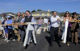 After 13 months since the PG&E explosion residents with Mayor Jim Ruane, left  and other officials remove the barricade blocking Glenview, Wednesday October 12, 2011, in San Bruno, Calif.