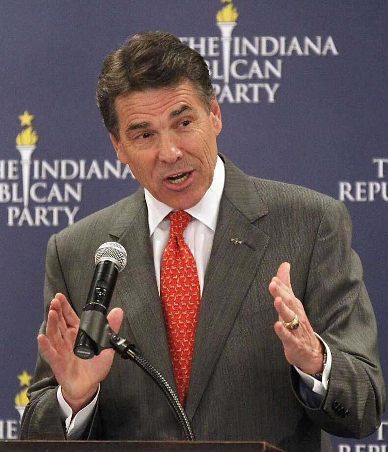 Republican presidential candidate, Texas Gov. Rick Perry speaks at GOP forum in Indianapolis, Wednesday, Oct. 12, 2011.  (AP Photo/Michael Conroy) Photo: Michael Conroy, AP