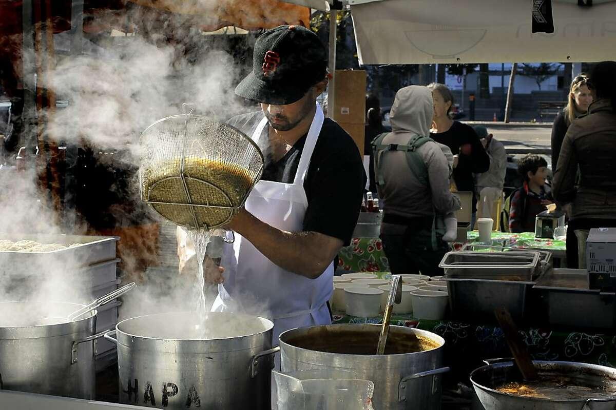 Owner, Richie Nakano, prepares fresh made ramen at Hapa Ramen in front of the Ferry Building, on Tuesday Nov. 9, 2010 in San Francisco, Calif. Ran on: 11-11-2010 Hapa Ramen owner Richie Nakano, making his ramen in front of the Ferry Building, uses such seasonal ingredients as sugar pie pumpkins and squash.