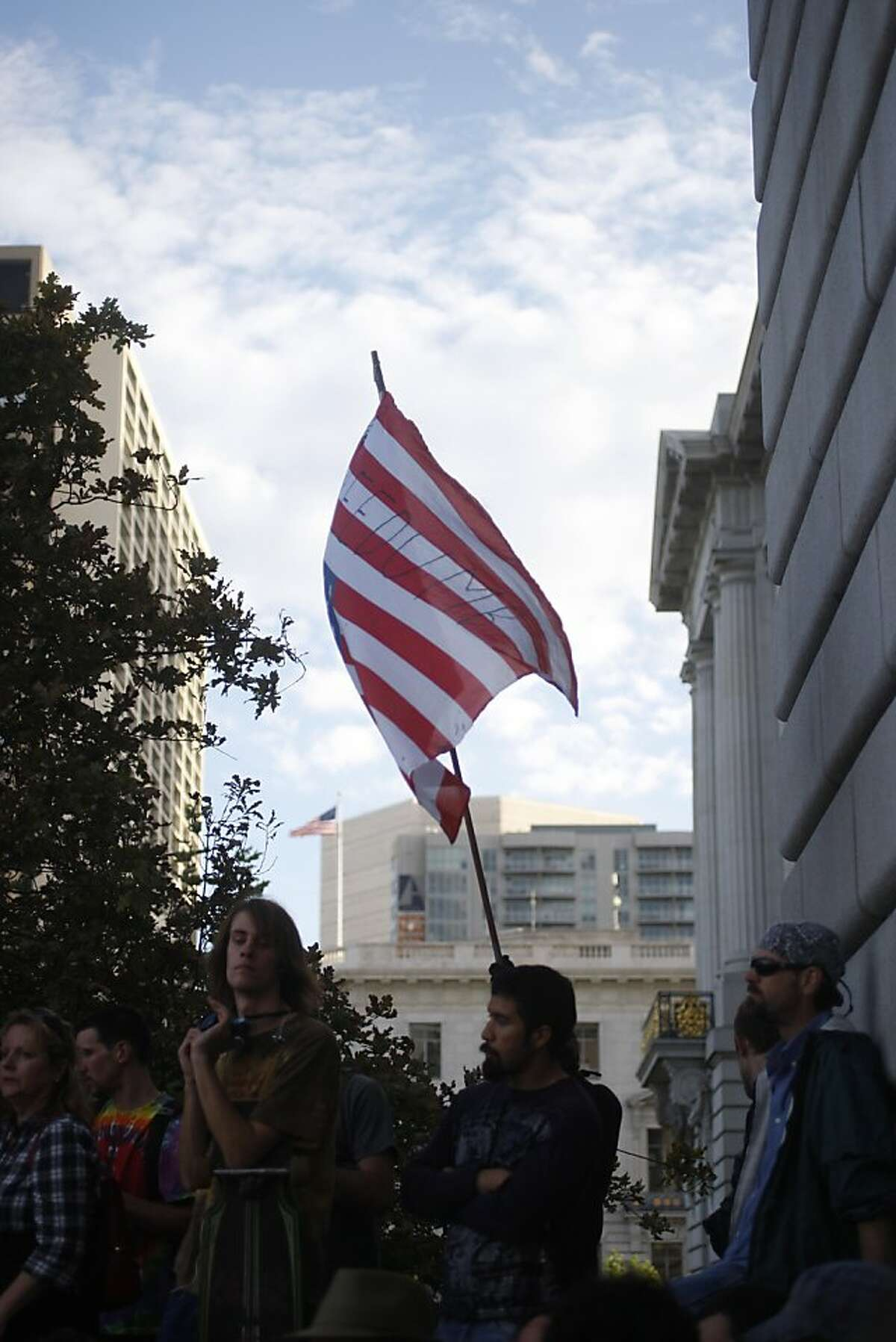 Protestors in the Occupy SF movement demonstrate outside of City Hall in San Francisco, Calif., on Saturday, Oct. 15, 2011.