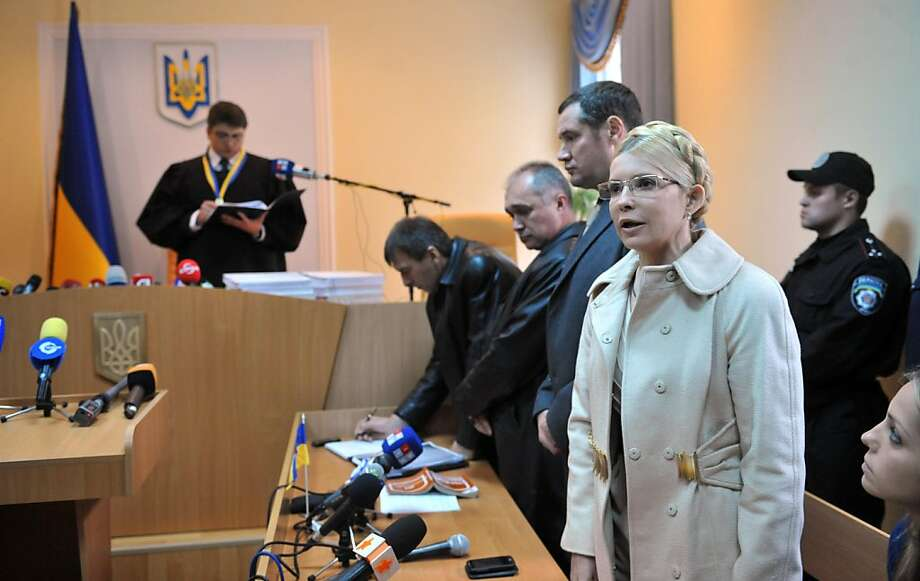 Yevgenia Karr (R) looks at her mother, former Ukrainian Prime Minister Yulia Tymoshenko, as she speaks in the courtroom as Judge Rodion Kireyev of the  Kiev Pechersky court reads the verdict to her  on October 11, 2011.  Tymoshenko was sentenced to seven years in jail for abusing her powers in a 2009 gas deal with Russia, a verdict that is set to harm ties with the European Union. Kireyev said the 10-year contract for gas imports from Russia had sustained heavy losses for Ukraine and ruled that her actions were criminal.   AFP PHOTO / SERGEI SUPINSKY (Photo credit should read SERGEI SUPINSKY/AFP/Getty Images) Photo: Sergei Supinsky, AFP/Getty Images
