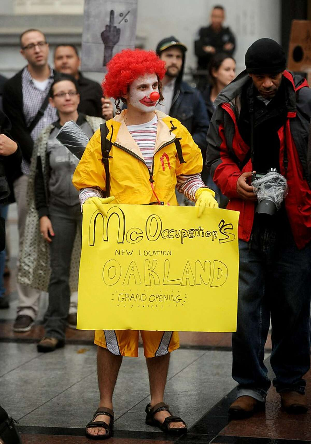 A protester dressed as Ronald McDonald who gave his name as Pipes, celebrates the spread of the Occupy protest movement to Oakland, Calif., on Monday, Oct. 10, 2011.
