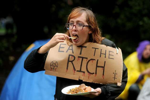Protester Monica Cumming eats dinner at the Occupy Oakland camp on Monday, Oct. 10, 2011, in Oakland, Calif. She consumed lentils and carrots. Photo: Noah Berger, Special To The Chronicle