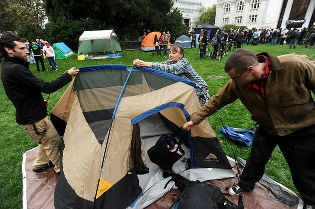 Occupy Oakland protesters set up camp outside city hall on Monday, Oct. 10, 2011, in Oakland, Calif. From left to right are Jacob Crawford, Emma Armstrong and Nick Walsh. Photo: Noah Berger, Special To The Chronicle