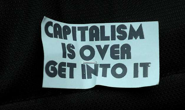 An anti-capitalism adorns an Occupy Oakland protester's backpack on Monday, Oct. 10, 2011, in Oakland, Calif. Photo: Noah Berger, Special To The Chronicle