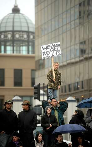 Jet Spencer, 11, stands on his father's shoulders while participating in an Occupy Oakland protester on Monday, Oct. 10, 2011, in Oakland, Calif. Photo: Noah Berger, Special To The Chronicle