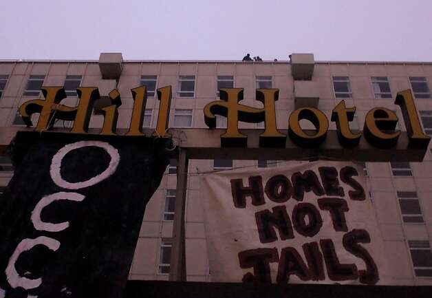 Activist go to the roof of the Cathedral Hotel to occupy, Monday October 10, 2011, in San Francisco, Calif.  Approximately thirty people homeless activists gathered at City Hall Plaza and then march the streets to the Cathedral Hotel to occupy to  protest  the waste of vacant buildings  that could be used for housing the homeless. Photo: Lacy Atkins, The Chronicle