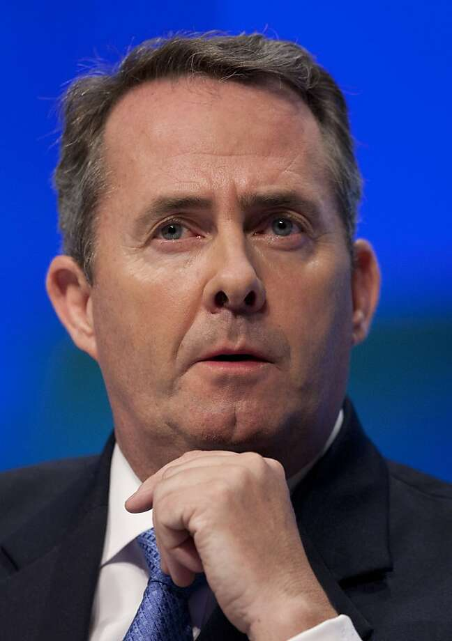 FILE - In this Wednesday, Oct. 5, 2011 file photo British Secretary of State for Defence Liam Fox waits to speak at Britain's Conservative Party Conference, Manchester, England. British Defence Secretary, Liam Fox has resigned, his office confirmed Friday Oct. 14, 2011. (AP Photo/Jon Super, File)  Ran on: 10-15-2011 Liam Fox says he blurred the lines of professional and private life. Photo: Jon Super, AP