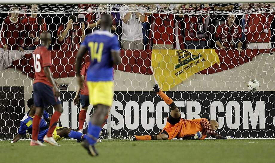 A ball headed by Ecuador forward Jaime Ayovi, not pictured, goes into the goal past the diving attempt of U.S. goalkeeper Tim Howard, right, in the second half of an international soccer friendly game, Tuesday, Oct. 11, 2011, in Harrison, N.J. (AP Photo/Julio Cortez) Photo: Julio Cortez, AP