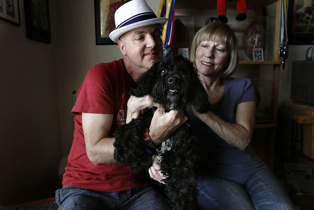 Eric W. McClendon with his wife Patricia and dog Bodie, at their San Francisco, Ca., home on Friday October 14, 2011. Eric credits the help from his wife and dog with overcoming his obsessive-compulsive disorders. McClendon, a board member with the obsessive-compulsive Foundation of the San Francisco Bay Area, is hosting a get-together in Palo Alto on Saturday, where others with obsessive-compulsive disorders can share their experiences with OCD and their efforts to gain control over their OCD.