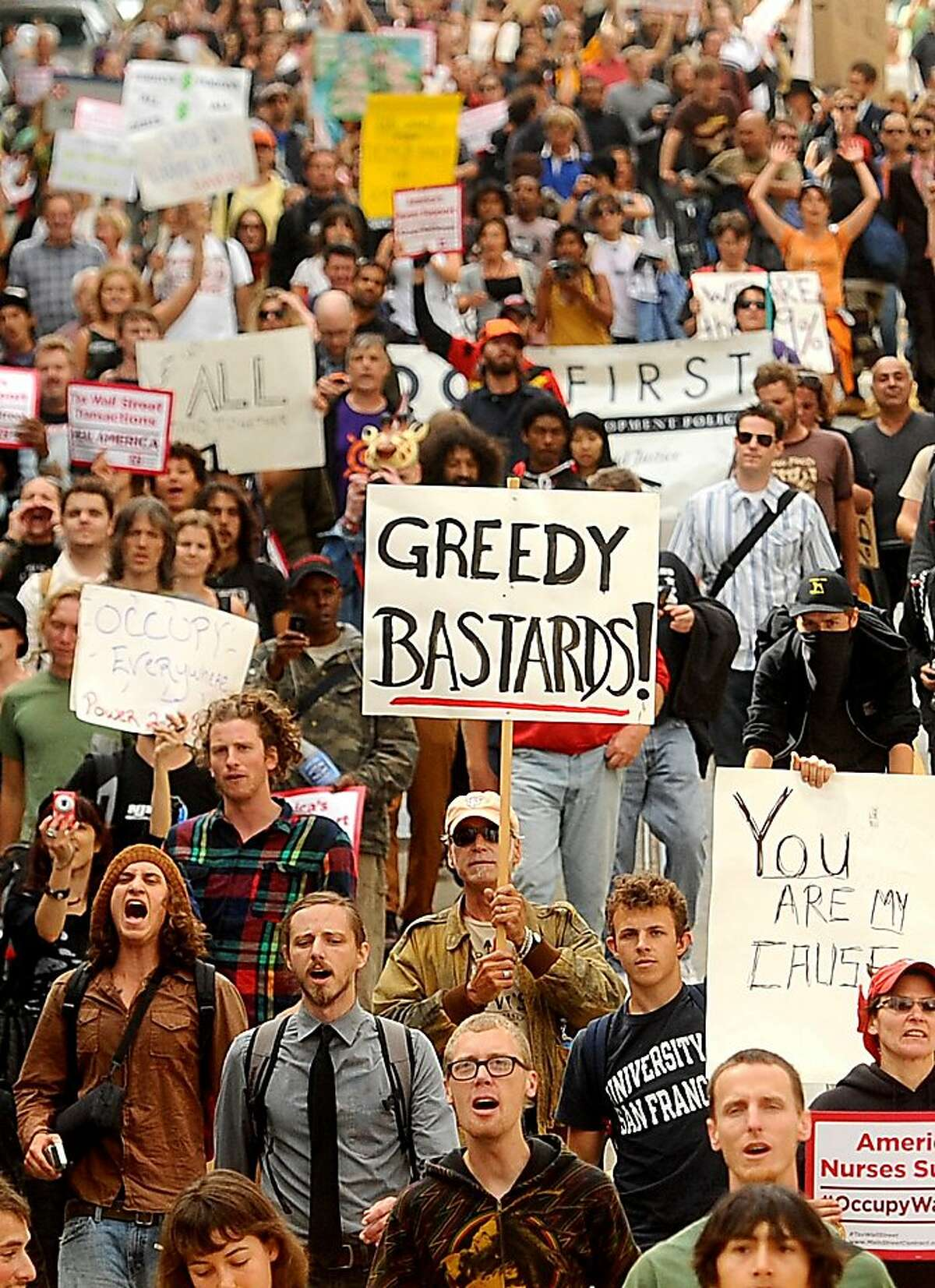 Protesters march down California St. during an OccupySF rally on Wednesday, Oct. 5, 2011, in San Francisco. The crowd numbered about 800 at its peak.