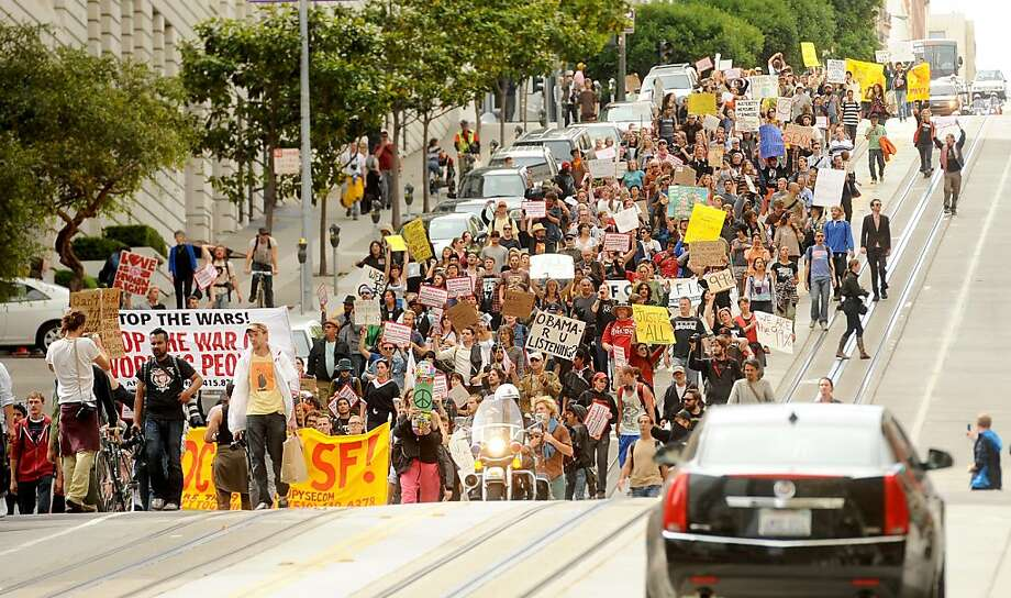 Protesters march down California St. during an OccupySF rally on Wednesday, Oct. 5, 2011, in San Francisco. The crowd numbered about 800 at its peak. Photo: Noah Berger, Special To The Chronicle