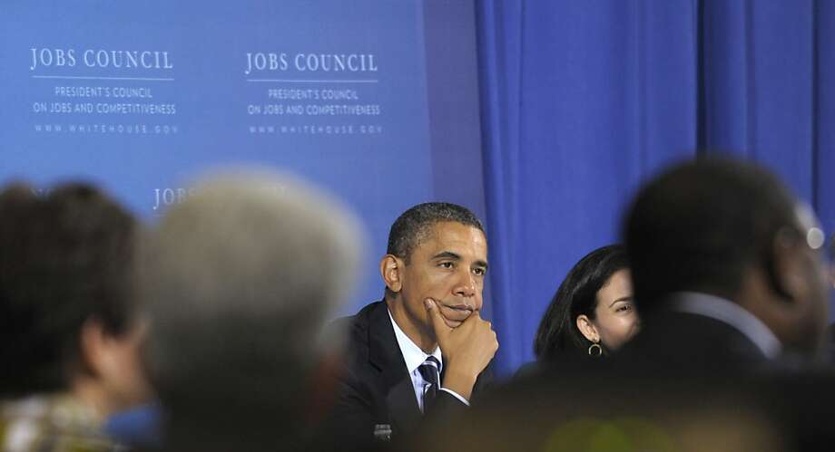 President Barack Obama listens to remarks during a meeting of the President's Council on Jobs at the International Brotherhood of Electrical Workers (IBEW) Local No. 5 Training Center in Pittsburgh, Tuesday, Oct. 11, 2011. (AP Photo/Susan Walsh) Photo: Susan Walsh, AP