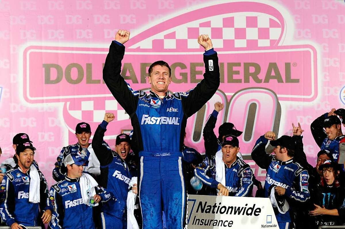 CHARLOTTE, NC - OCTOBER 14: Carl Edwards, driver of the #60 Fastenal Ford, celebrates in Victory Lane after winning the NASCAR Nationwide Series Dollar General 300 Miles of Courage at Charlotte Motor Speedway on October 14, 2011 in Charlotte, North Carolina. (Photo by Jason Smith/Getty Images for NASCAR)