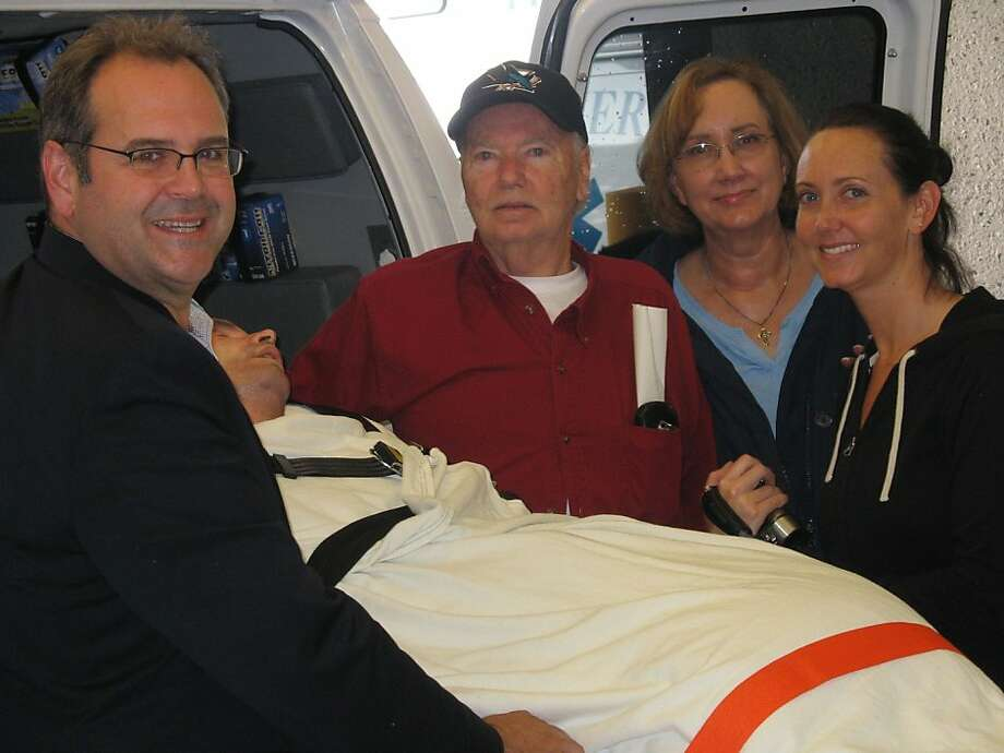 Bryan Stow with his family on right (parents Dave and Ann Stow and sister Bonnie Stow,) and Dr. Geoff Manley on left leaving SFGH by ambulance on the morning of Tuesday, October 11, 2011. Photo: Courtesy SF General Hospital