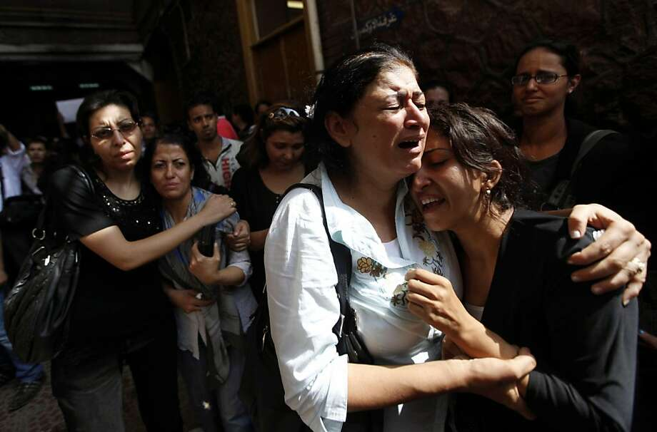 Egyptian relatives of 17 of the Copts who were killed during clashes with the Egyptian army late Sunday, react after seeing their bodies outside the morgue of the Copts' hospital in Cairo, Egypt, Monday, Oct. 10, 2011. Egypt's Coptic church blasted authorities Monday for allowing repeated attacks on Christians with impunity as the death toll from a night of rioting rose to more than two dozen, most of them Christians who were trying to stage a peaceful protest in Cairo over an attack on a church. (AP Photo/Khalil Hamra) Photo: Khalil Hamra, AP
