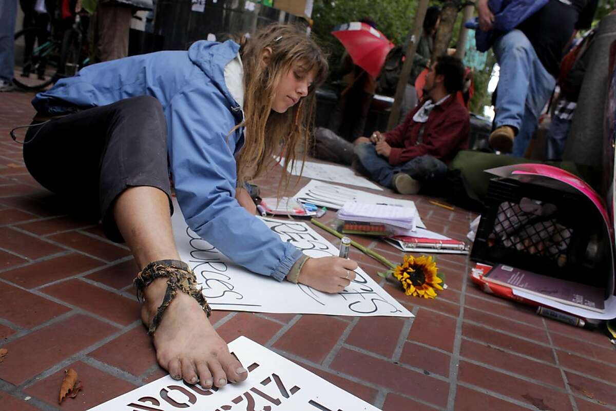 Lindsay Millichap makes protest signs as she and the group Occupy SF protest outside the Federal Reserve Bank of San Francisco with the Thursday Oct. 6, 2011, in San Francisco, Calif.