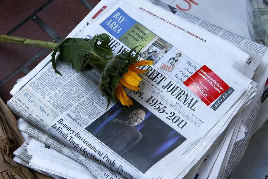 A lone sunflower sits amid  the belongs of the protesters of the group Occupy SF outside the Federal Reserve Bank of San Francisco, where the group set camp yesterday and continued to protest,  Thursday Oct. 6, 2011, in San Francisco, Calif. Photo: Lacy Atkins, The Chronicle