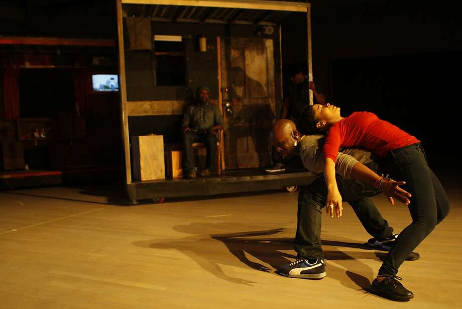 "A dress rehearsal for Marc Bamuthi Joseph's multimedia performance piece, ""Red, Black & Green"", at the Yerba Buena Center for the Arts in San Francisco, Calif., on Thursday, Oct. 13, 2011.  At right, Joseph dances with Traci Tolmaire. Photo: Dylan Entelis, The Chronicle"