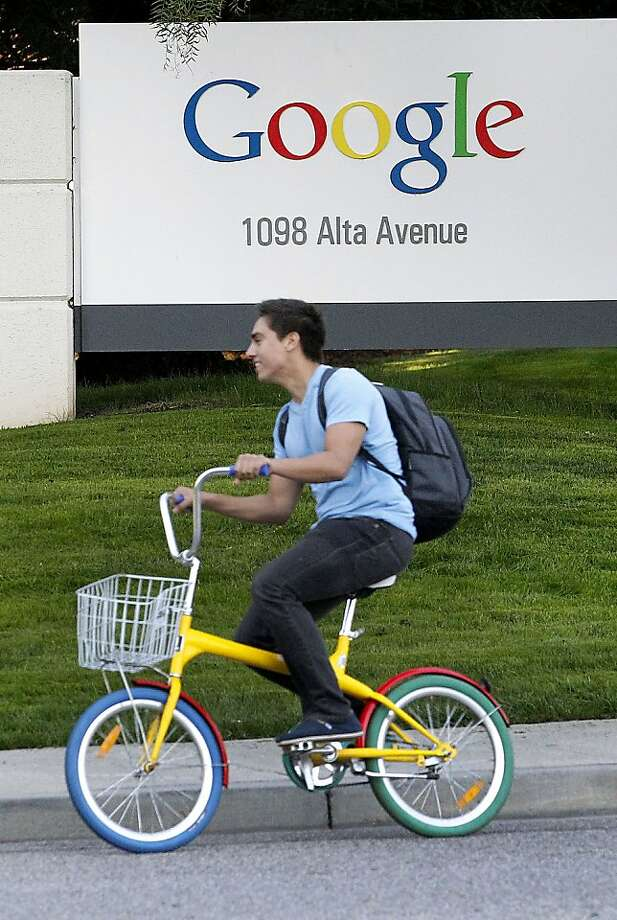 "A Google Inc. employee rides a ""G-bike"" past signage displayed company headquarters in Mountain View, California, U.S., on Thursday, Oct. 13, 2011. Google Inc. is expected to announce quarterly eanrings today after U.S. financial markets close. Photographer: Tony Avelar/Bloomberg Photo: Tony Avelar, Bloomberg"