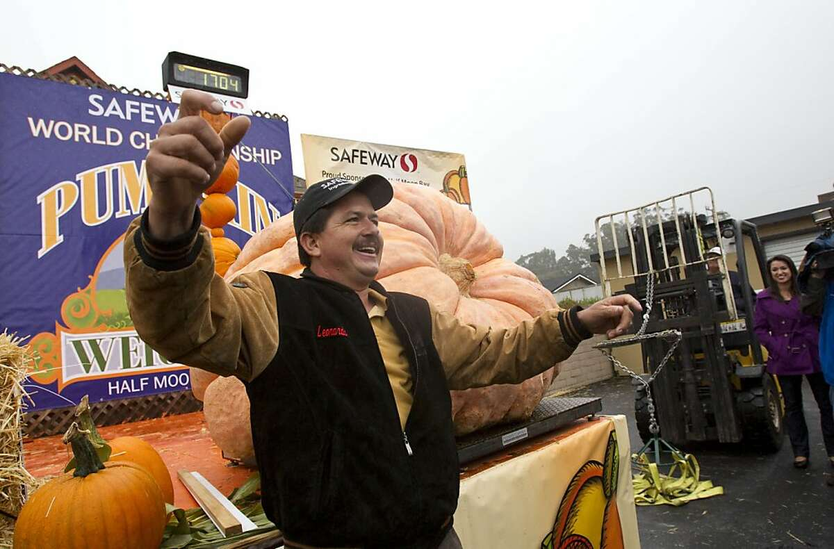 Leonardo Urena from Napa waves to the crowd after his pumpkin was weighed in 1,704 pounds at at the 38th Annual Safeway World Championship Pumpkin Weigh-Off in Half Moon Bay, Calif., on Monday, October 10, 2011. Urena won the contest and set a new California state record with his pumpkin.