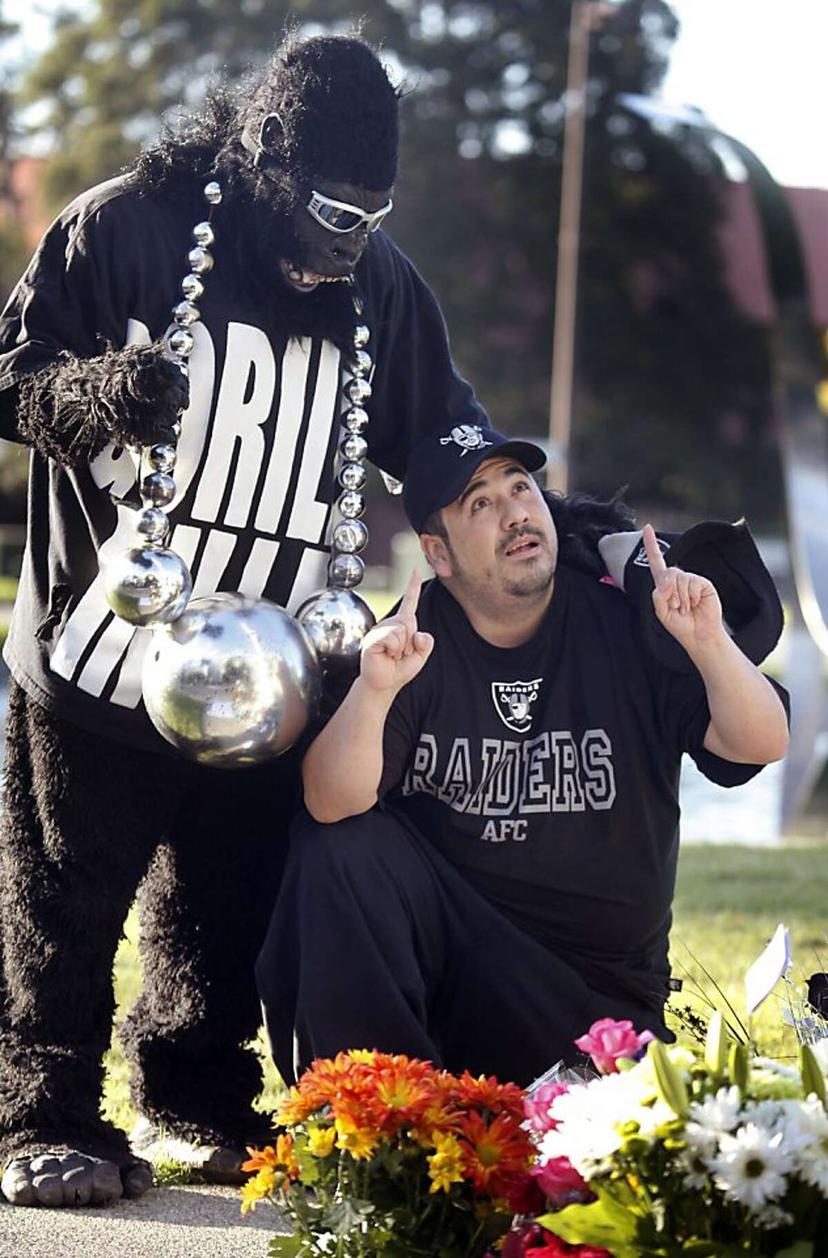Mark Acasio, from Brentwood California is the Gorilla Rilla man and Michael Jimenez from Alameda are concerned about the Oakland Raiders future after the death of Al Davis; the Raiders managing general partner Saturday October 7, 2011. Davis was 82.